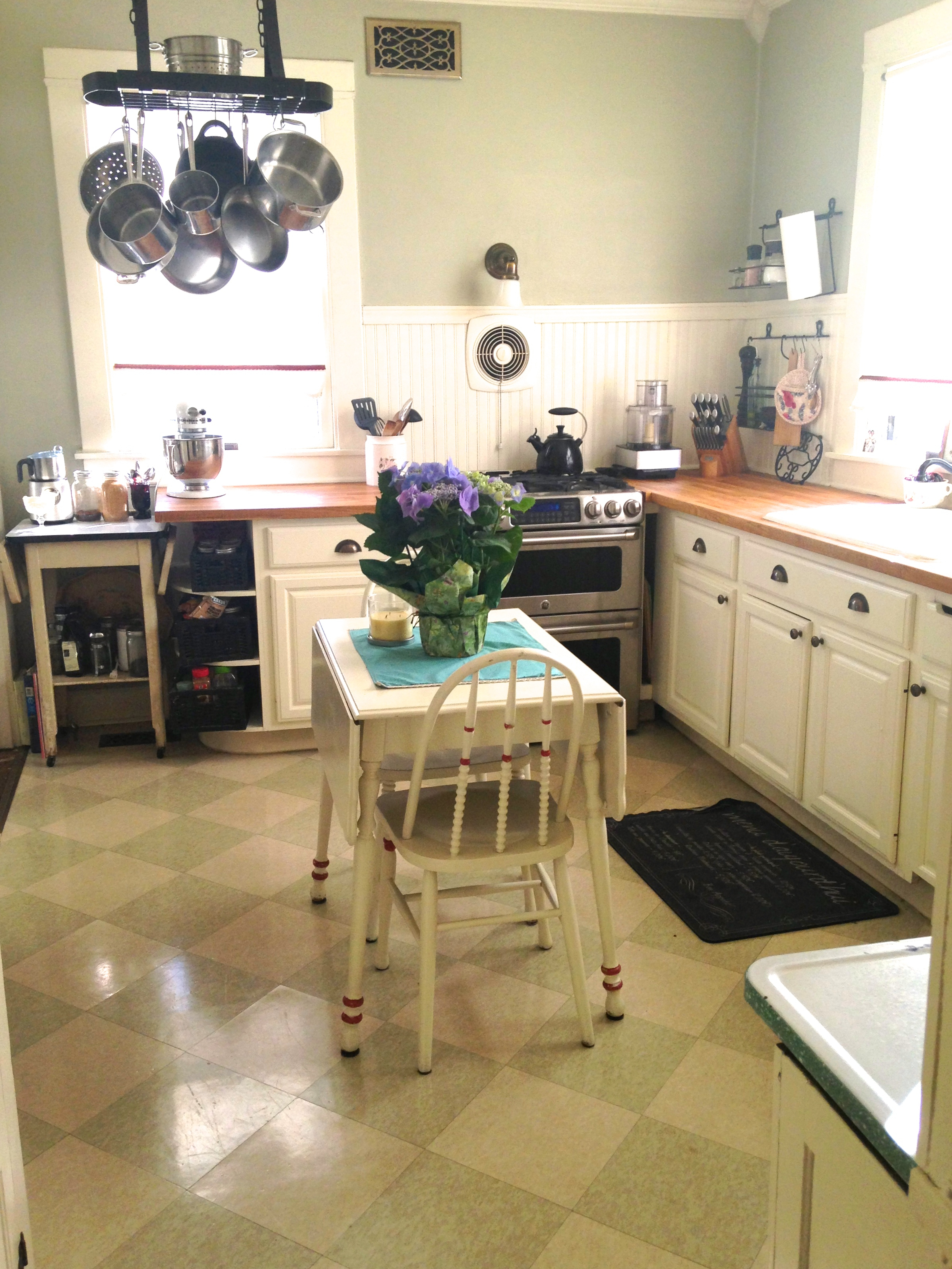 How to make small kitchens appear bigger the catholic table for Looking for kitchen